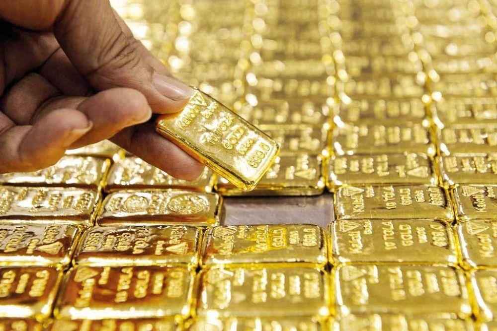 Giá vàng hôm nay 12/10: Tiếp đà giảm trước sức ép của đồng USD - Ảnh 1.