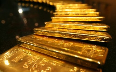 Giá vàng hôm nay 7/10: Bật tăng trở lại, bất chấp USD mạnh lên - Ảnh 1.