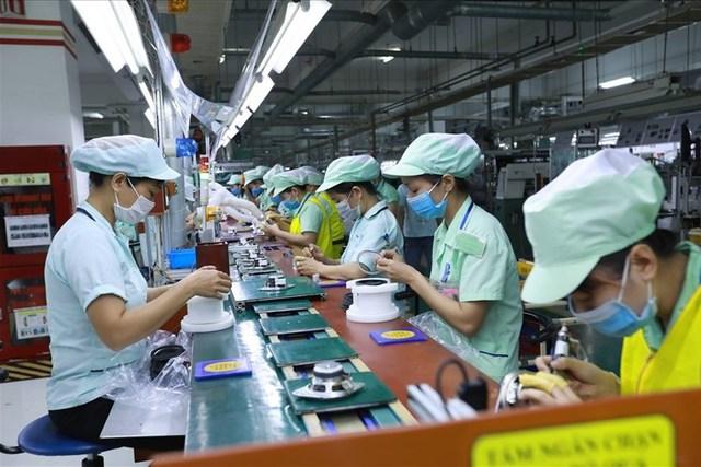 Nâng cao mức sống, cải thiện điều kiện làm việc của người lao động - Ảnh 1.